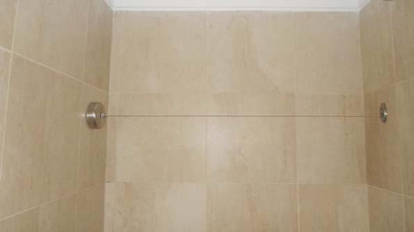 Varal retrátil para o banheiro do seu hotel, prático e discreto